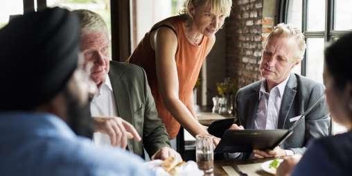 Business people dining together concept PCJMRMU