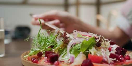 Eat salad in the restaurant JUHVHUK